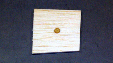 The plywood circle reinforces the center of the plug.