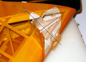 The propeller caused a lot of damaged when it sliced through the wing.
