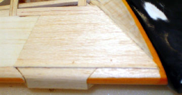 The gap is filled with water base glue which will expand the wood strip to fill the gap.